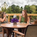 two women enjoying a meal and talking on the intracoastal deck at Best Western Plus Myrtle Beach@Intracoasta